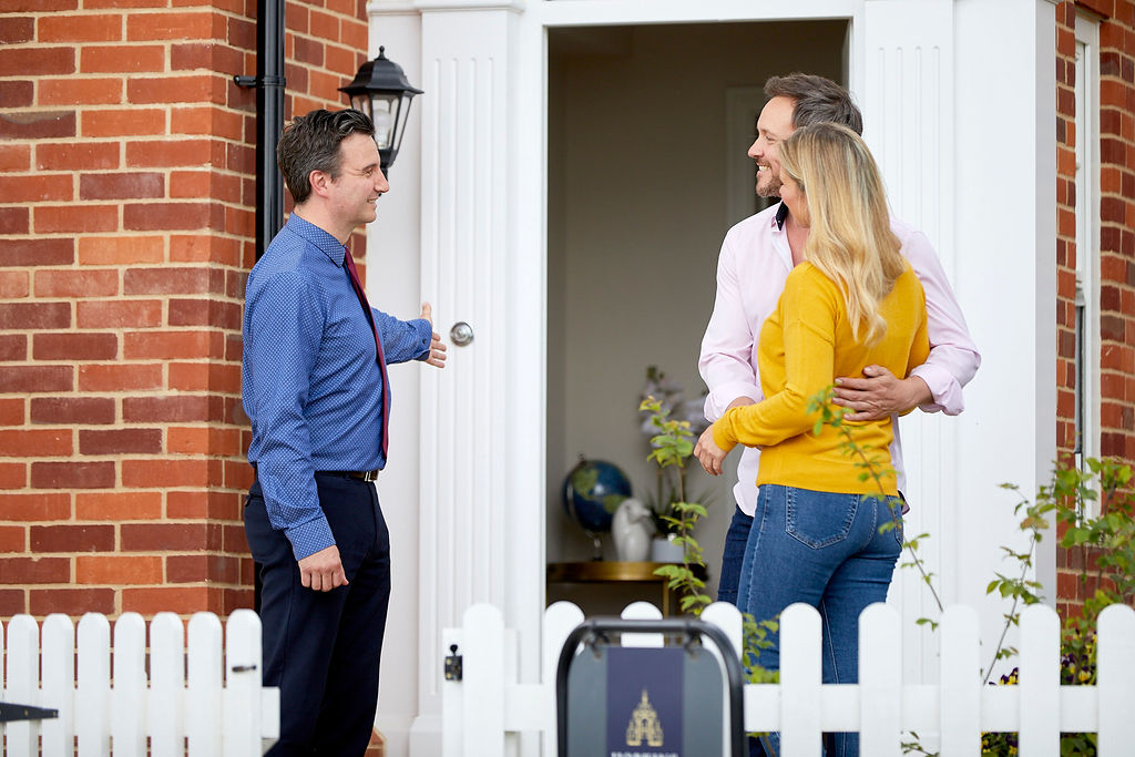 Hopkins representative with a couple at the door of a showhome